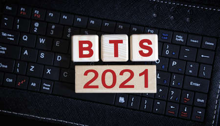 BTS 2021 concept. Wooden cubes on a black keyboard