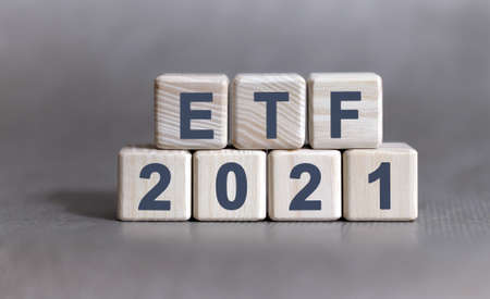 ETF text on wooden cubes on a monochrome background