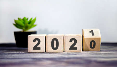 Wooden blocks for change year 2020 to 2021. New year and holiday concept.