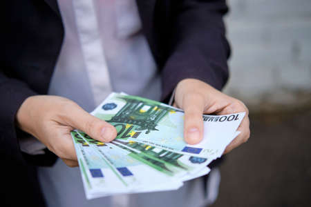 Businessman holds paper money, currency from the euro Stock fotó