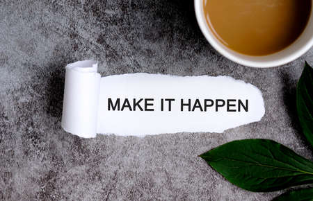 Make it happen with cup of coffee and green leaf