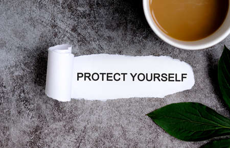 PROTECT YOURSELF with cup of coffee and green leaf