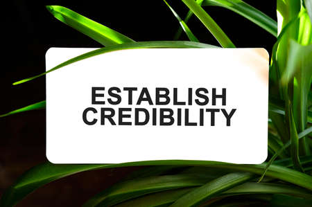 ESTABLISH CREDIBILITY text on white surrounded by green leaves
