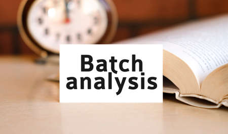 Batch analysis business concept text on a white book and clock