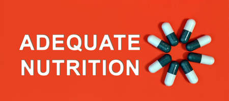 Adequate nutrition - white text on a red background with pill capsules