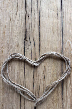 heart of thread on a wooden background photo