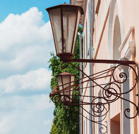 impasse: Street lamps on a building wall retro forging Stock Photo
