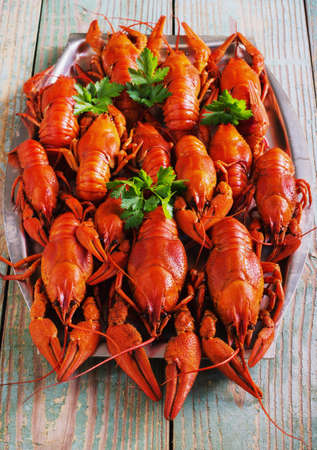 cancers: crawfish on wooden background in a plate
