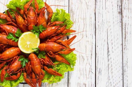 crawfish on wooden white background in a plate