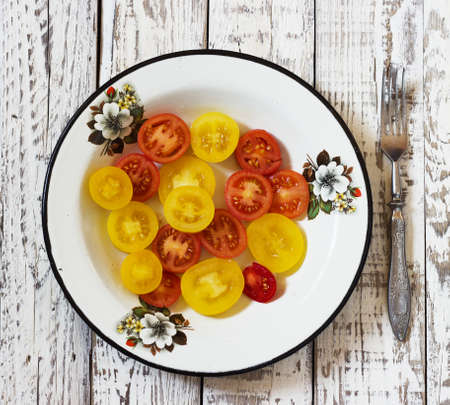 lycopene: organic tomatoes, organic colorful tomatoes, colorful tomato in galvanized bowl  in rural atmosphere. colorful tomato in galvanized bowl . fresh tomatoes.