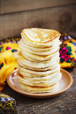 Staple of yeast pancakes, traditional for Russian pancake week rustic Stock Photo