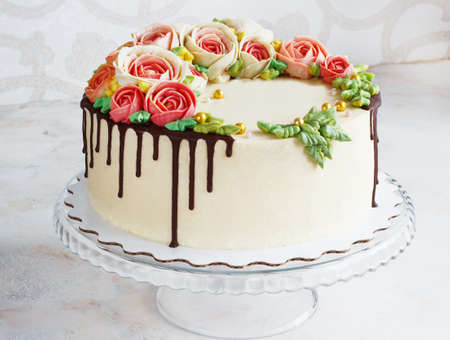 Birthday cake with flowers rose on white background Archivio Fotografico