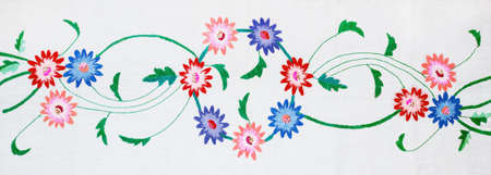 embroidered flowers on a white background, handmade.