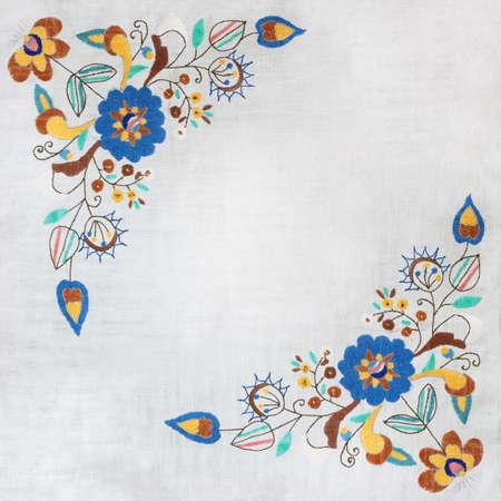 Folk frame made of handmade embroidery elements.