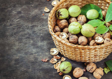 Whole Walnuts and Cleared in the basket Black Wooden Background Top view Healthy concept