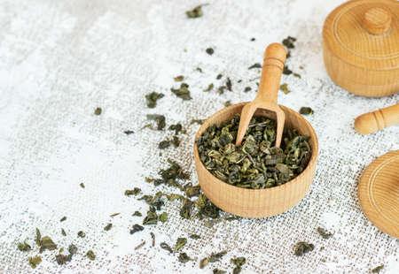 aromatic green dry tea on light coloured white Stock Photo