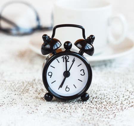 Black alarm clock on white background,concept morning