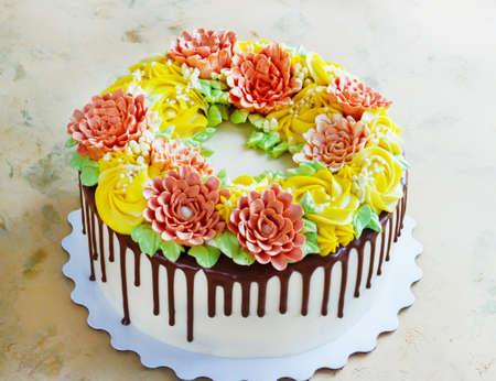 Birthday cake with flowers rose on white background. Stock Photo