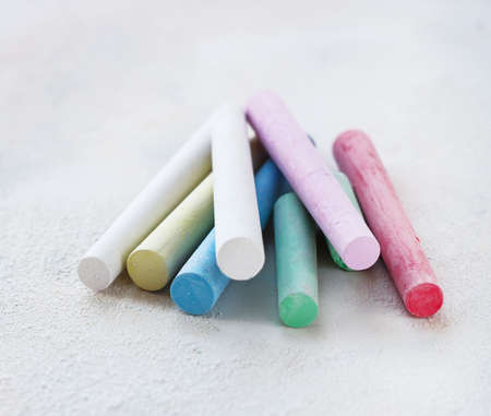 chalks in a variety of colors arranged on a white background Stock Photo