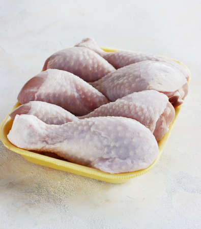fresh raw chicken pieces on a light background in a tray Stock Photo