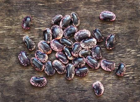 dark beans on a dark wooden background