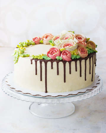 Birthday cake with flowers rose on white background Stockfoto
