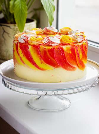 Bright festive cake with roses on the windowsill Reklamní fotografie