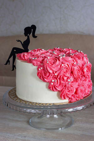 Birthday cake for young lady decorated with flowers. cream cake with flowers for a girl