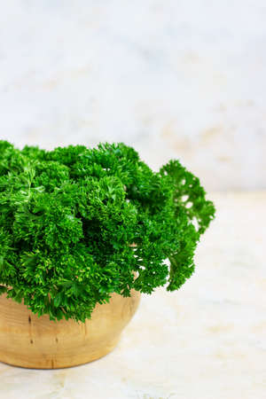 fresh parsley on a light background. A bunch of parsley, vegetarianism