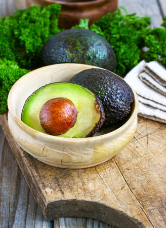 food background with fresh organic avocado on old wooden table, top view, copy space