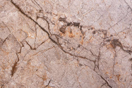 Texture of walls with cracks and scratches. Gold marble pattern. Background image of the stone surface. An old and worn-out wall. It can be used for interior-exterior home decor