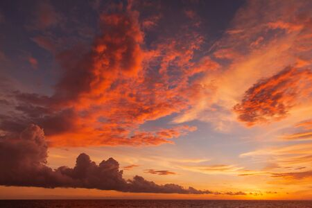 indian ocean: Sunset with clouds of different shapes. Bali, Indonesia, Indian ocean. Stock Photo