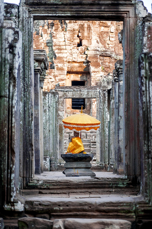 sacral: Sanctuary with Buddha statue and sacral decorations in Angkor Wat, a temple complex in Cambodia and the largest religious monument in the world.