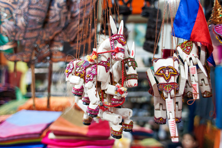 puppet: Sale of souvenirs in the market, Siem Reap, Cambodia. Funny handmade wooden puppets donkeys and elephants with bright colorful harness.