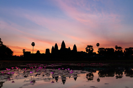 temple tower: Sunrise in Angkor Wat, a temple complex in Cambodia and the largest religious monument in the world.