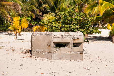 guerrilla: Old earth-and-timber emplacement on caribbean beach of Cuba. Military facility of times of guerrilla war in Cuba.