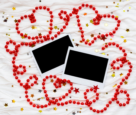 winter photos: Winter background with decorative sparkling stars, beads and photos. Empty photo frames for your picture or text.