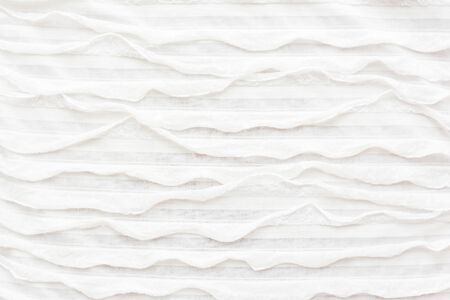 ruche: Abstract textile background. White fabric with ruche.