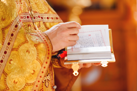 vestment: Prayer book in the hands of the priest. Ceremony in the Orthodox Christian Church. Russia.