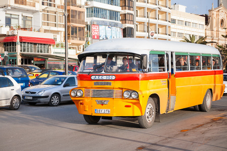 60's: Colorful old British buses from the 60s were used as public transport in Malta.