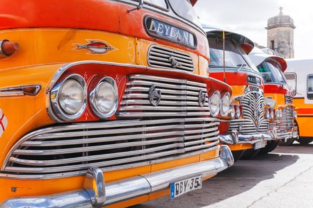 Colorful old British buses from the 60s were used as public transport in Malta.