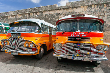 60s: VALLETTA, MALTA - February 13, 2010. Colorful old British buses from the 60s were used as public transport in Malta.