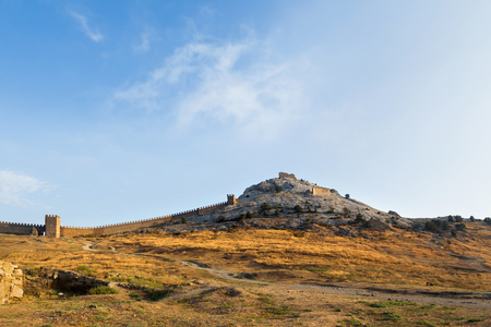 genoese: Ancient Genoese fortress in Sudak town. Panorama view at sunset. Crimea, Russia.
