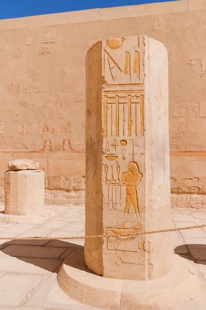 sacral: Mortuary temple of Hatshepsut in Deir el-Bahari. Ancient wall with the engraved Egyptian hieroglyphs. Deir el-Bahari, Egypt.