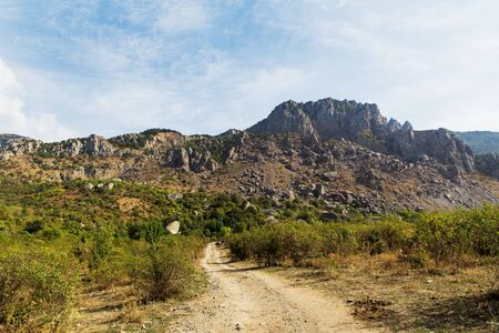 ghost rock: Path to famous Ghost Valley with strangly shaped rocks. Demerdji mountains. Crimea, Russia. Stock Photo
