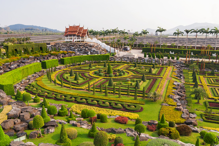 Nong Nooch Tropical Garden in Pattaya, Thailand. Panorama landscape view of formal garden.
