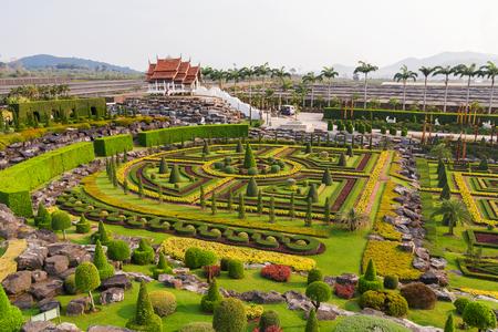 Nong Nooch Tropical Garden in Pattaya, Thailand. Panorama landscape view of formal garden.