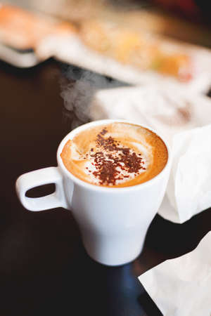 cappuccino cup: Cup of coffee with cinnamon. Hot tasty cappucino in white mug.