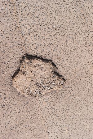 breakage: Crack in asphalt. Damaged pavement. Poor condition of the road surface.