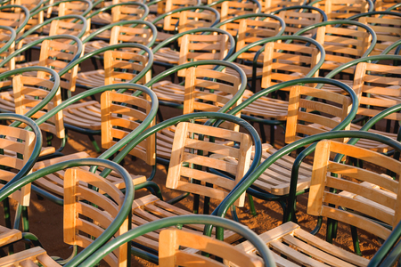 onlooker: Wooden chairs. Empty stools without people. Concept photo - absence of audience. Stock Photo